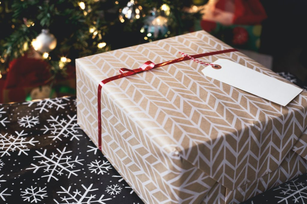 Gold and white wrapped company christmas gift